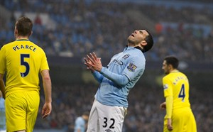 Manchester City's Carlos Tevez reacts after a missed opportunity, during his team's English Premier League soccer match against Reading at The Etihad Stadium, Manchester, England, Saturday Dec. 22, 2012. (AP Photo/Jon Super)
