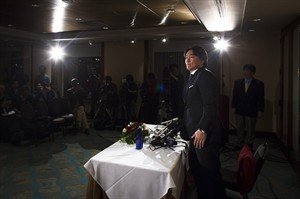 Japanese baseball player Hideki Matsui stands up to leave after a news conference, Thursday, Dec. 27, 2012, in New York. The 38-year-old former New York Yankees outfielder, World Series MVP, and two-time All Star announced his retirement from baseball Thursday following months of free agency after his release from the Tampa Bay Rays in August. (AP Photo/John Minchillo)