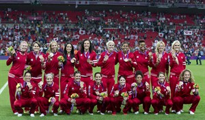 The players on the Canadian women's soccer team have won The Canadian Press Team of the Year award. The team poses for a group photo and show off their Bronze medals at the Olympic Games in London on Thursday August 9, 2012. THE CANADIAN PRESS/Frank Gunn