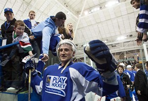 Tampa Bay Lightning's Steven Stamkos celebrates with fans following an RBC charity hockey game in Toronto, Wednesday, Dec. 19, 2012. THE CANADIAN PRESS/ Jesse Johnston
