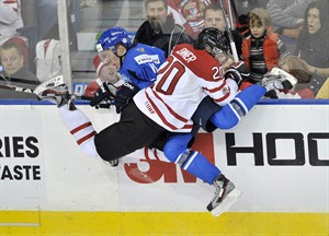 Team Canada forward Boone Jenner (front) takes out Team Finland forward Markus Granlund during first period IIHF World Junior Championships hockey action in Edmonton, on Monday, Dec. 26, 2011. Both Jenner and Granlund will lead their respective teams at the World Junior tournament which starts in Ufa, Russia on Dec.26. THE CANADIAN PRESS/Nathan Denette