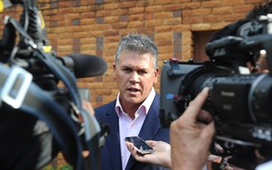 Peet van Zyl, managing agent for Olympian athlete Oscar Pistorius, talks to the press outside the Brooklyn police station in Pretoria, South Africa, Sunday, Feb. 17, 2013, after visiting Pistorius. Oscar Pistorius faces a bail hearing Tuesday and Wednesday, in which prosecutors will have to offer a great explanation about why they've charged the Olympian with murder over the Valentine's Day shooting death of his model girlfriend Reeva Steenkamp. Pistorius hasn't entered a plea in the case, though his family has said they strongly deny the 26-year-old double-amputee runner committed murder. They have not, however, denied outright that Pistorius shot Steenkamp, a 29-year-old law school graduate now being featured in a South African reality television show. (AP Photo)