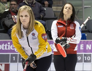 Manitoba skip Jennifer Jones, left, lines up a shot as Team Canada skip Heather Nedohin looks on during tenth draw curling action at the Scotties Tournament of Hearts Wednesday, February 20, 2013 in Kingston, Ont.THE CANADIAN PRESS/Ryan Remiorz