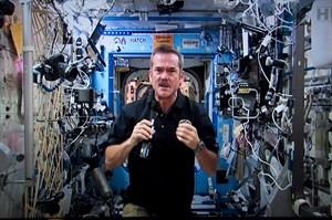 Canadian astronaut Chris Hadfield responds to a question during a news conference from the International Space Station on a photograph taken from a television monitor on Thursday, January 10, 2013 in St-Hubert, Que. THE CANADIAN PRESS/Paul Chiasson