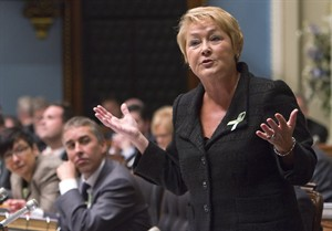 Quebec Premier Pauline Marois gestures during question period at the Quebec legislature, Wednesday February 13, 2013. THE CANADIAN PRESS/Clement Allard