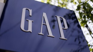 This photo taken on May 14, 2014, shows signage outside a Gap store in the Shadyside section of Pittsburgh. The Gap Inc. reports quarterly financial results after the market closes Thursday, May 21, 2015. (AP Photo/Gene J. Puskar)