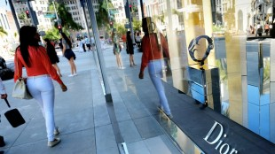 In this Thursday, April 2, 2015 photo, shoppers walk past a Dior luxury goods shop on Rodeo Drive in Beverly Hills, Calif. The Labor Department releases the Consumer Price Index for April on Friday, May 22, 2015. (AP Photo/Richard Vogel)
