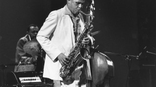 FILE - In this June 28, 1980 file photo, saxophonist Dexter Gordon performs at the Charlie Parker tribute at Carnegie Hall in New York. Gordon and pianists James P. Johnson and Lennie Tristano are the newest inductees into Jazz at Lincoln Center's Ertegun Jazz Hall of Fame. Gordon was considered the first tenor saxophonist to adapt the new bebop style pioneered by Charlie Parker in the 1940s. JALC announced the 2015 inductees Friday, May 22, 2015. (AP Photo, File)