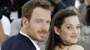 Actors Michael Fassbender, left, and Marion Cotillard pose for photographers during a photo call for the film Macbeth, at the 68th international film festival, Cannes, southern France, Saturday, May 23, 2015. (AP Photo/Lionel Cironneau)