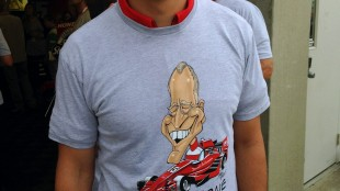 "Graham Rahal, a member of the Rahal Letterman Lanigan (RLL) racing team, poses wearing a (hash)thanksdave t-shirt before the start of the Indianapolis 500 on Sunday, May 24, 2015, at the Indianapolis Motor Speedway in Indianapolis. Letterman's IndyCar team paid tribute to the former ""Late Show"" host by putting a caricature of his face and (hash)thanksdave on driver Oriol Servia's yellow car for Sunday's race. (AP Photo/Dan Gelston)"