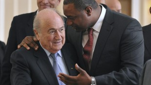 FILE - In this Wednesday, May 23, 2012 file photo the newly elected president of CONCACAF Jeffrey Webb talks to FIFA President Sepp Blatter, left, as they arrive at the meeting of the Confederation of North, Central American and Caribbean Association Football (CONCACAF), prior to the two-day congress of FIFA in Budapest, Hungary. Webb is among the soccer officials that were arrested and detained by Swiss police on Wednesday, May 27, 2015, at the request of U.S. authorities after a raid at Baur au Lac Hotel in Zurich. (Szilard Koszticsak/MTI via AP, File)