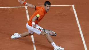 Serbia's Novak Djokovic returns in the second round match of the French Open tennis tournament against Luxembourg's Gilles Muller at the Roland Garros stadium, in Paris, France, Thursday, May 28, 2015. (AP Photo/Francois Mori)