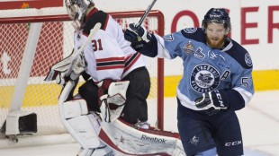 Rimouski Oceanic's Christopher Clapperton, right, celebrates his team's second goal against Quebec Remparts goalie Zachary Fucale during first period action Wednesday, May 27, 2015 at the Memorial Cup in Quebec City. Remparts' coach Philippe Boucher is standing by his criticism of a referee after the Quebec Remparts' loss to the Rimouski Oceanic, even if he will likely draw a fine. THE CANADIAN PRESS/Jacques Boissinot