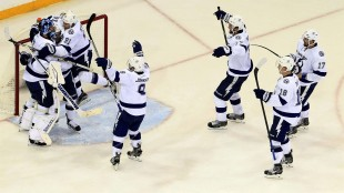 Tampa Bay Lightning goalie Ben Bishop (30) is is congratulated by teammates after Game 7 of the Eastern Conference finals against the New York Rangers in the NHL hockey Stanley Cup playoffs, Friday, May 29, 2015, in New York. The Lightning won 2-0 and advanced to the Stanley Cup Finals. (Dirk Shadd/Tampa Bay Times via AP)