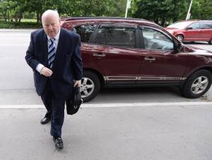 Suspended Senator Mike Duffy heads to court in Ottawa on Monday, June 1, 2015. Duffy faces 31 charges, including fraud, breach of trust and bribery. THE CANADIAN PRESS/Sean Kilpatrick