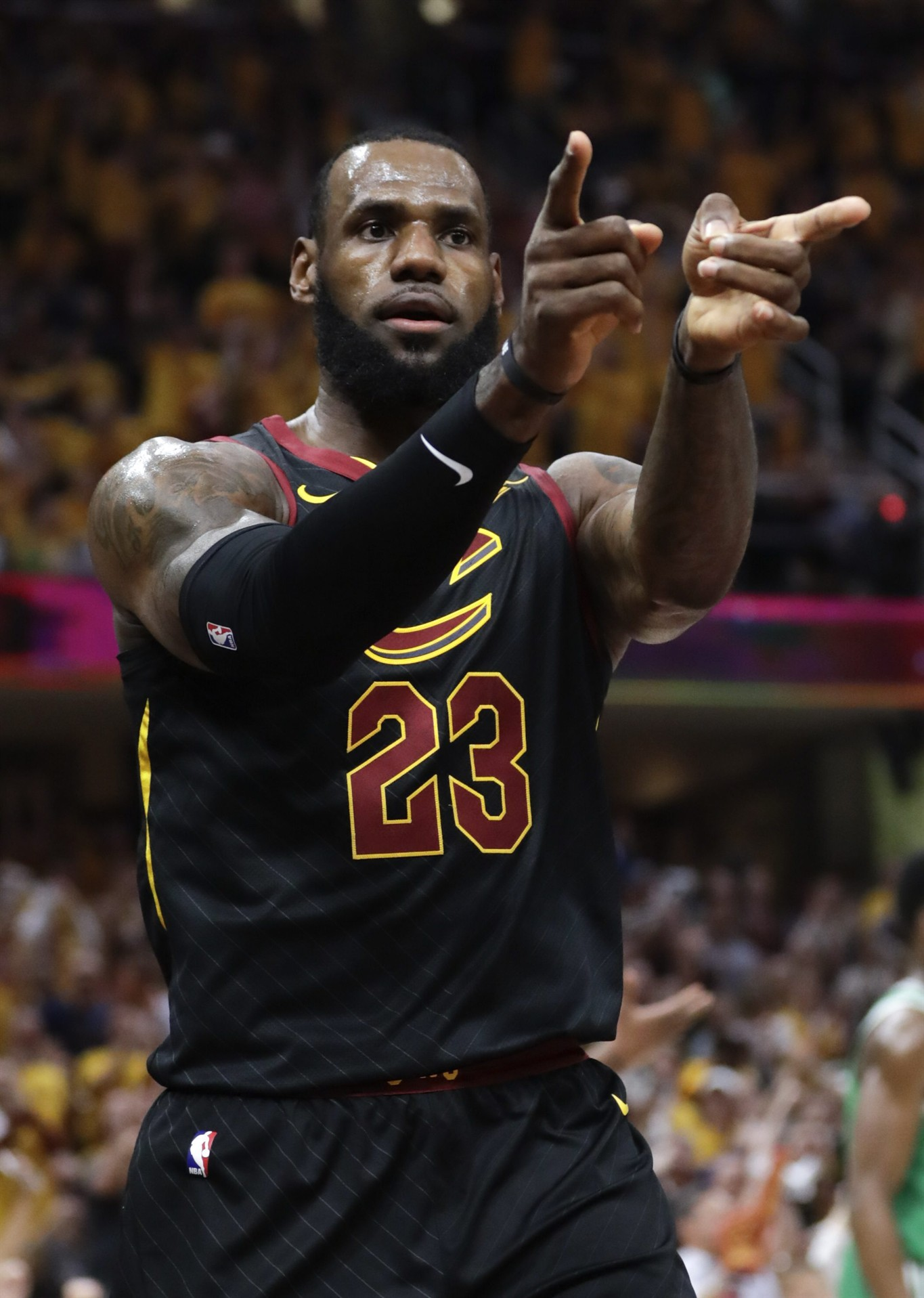 a2d84e84a38b Cleveland Cavaliers  LeBron James (23) reacts after a play against the  Boston Celtics in the first half of Game 4 of the NBA basketball Eastern  Conference ...